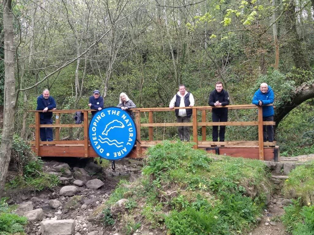 People stood on a bridge