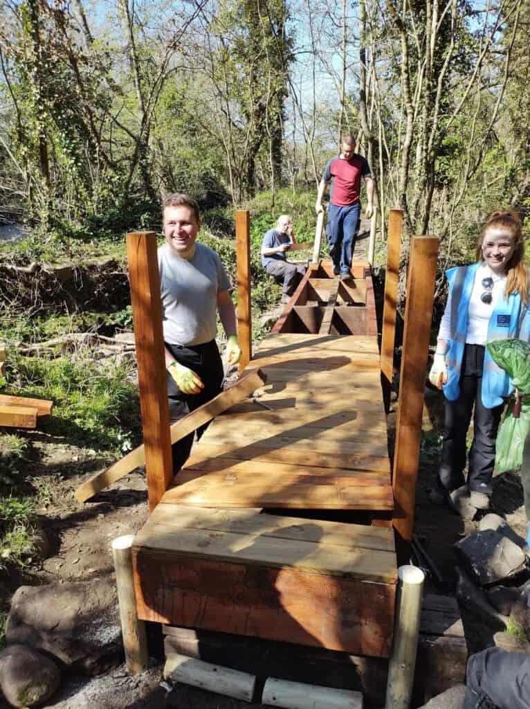 Ryan Harrison and Hannah Gordon help build the bridge at Seven Arches