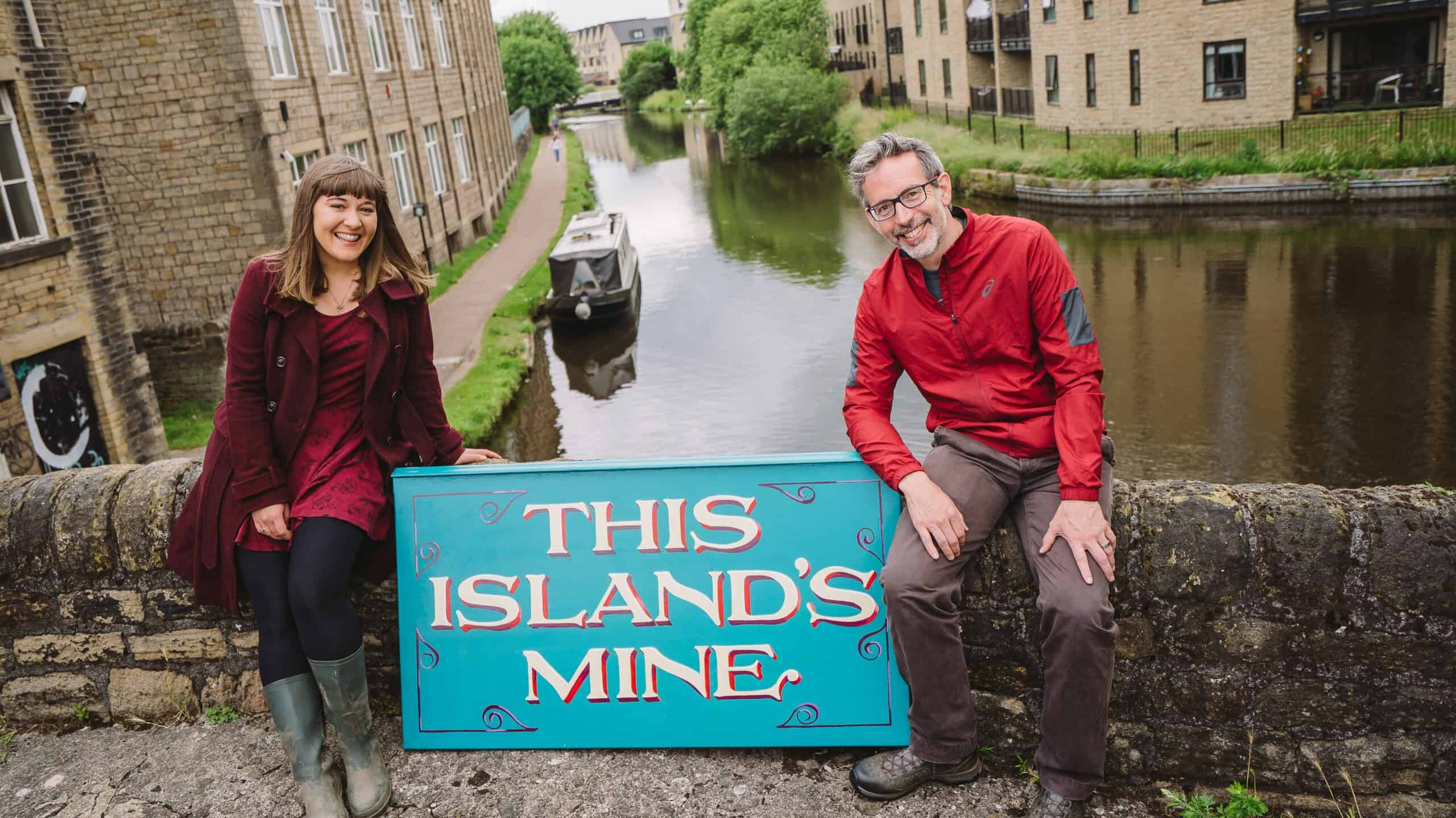 Actors with a canal boat in the background